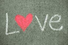 Wort-Liebe mit Herzen Stockbild