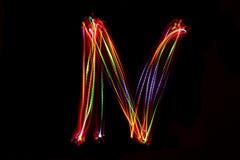 Wort ` N ` Schreiben vom Licht Lizenzfreies Stockbild