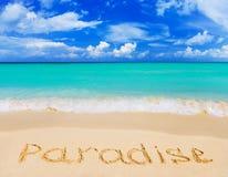 Wort-Paradies auf Strand Stockfotos