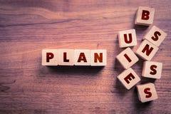 Wort-Plan-Ideen-Aktion und Geldsack lizenzfreies stockfoto