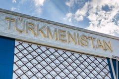 Wort-Turkmenistan-Emblem, Text und Insignien-Thema Stockbild