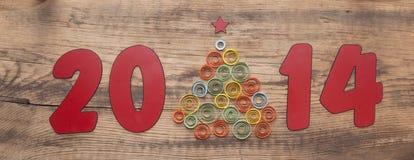 Wort 2014 und kräuselnder Papierweihnachtsbaum Lizenzfreies Stockfoto