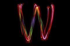 Wort ` W ` Schreiben vom Licht Lizenzfreies Stockbild