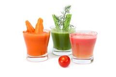 Wortel, selderie en tomatesap Stock Afbeelding