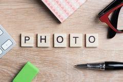 Wortfoto von Blöcken als Fotografiekonzept auf Geschäftsarbeitsplatz Lizenzfreies Stockbild