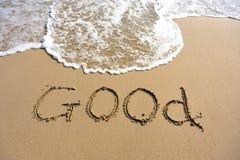 Wortgutes gezeichnet auf den Strand Lizenzfreies Stockbild