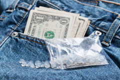 Worth of drugs. Crystal meth on jeans with many dollars Royalty Free Stock Photo
