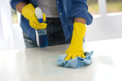 Worth girl cleaning the table Royalty Free Stock Photography