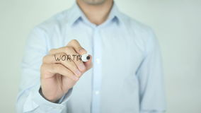 Worth the Risk?, Writing On Transparent Screen. Man writing stock footage