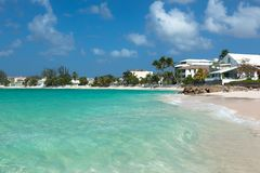 Worthing beach in Barbados. Beach with palm trees on ocean royalty free stock photo