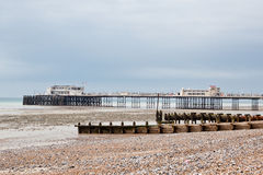 Worthing beach and pier in a cloudy day, low tide, England. Royalty Free Stock Image