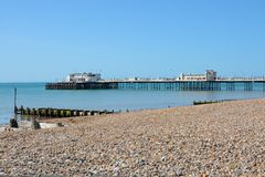 Worthing beach and pier. England. Pier, seafront and beach at Worthing, West Sussex, England Royalty Free Stock Photos
