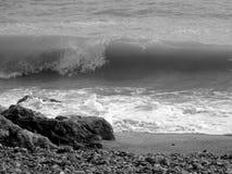 Worthing beach 1. Wave breaking on rocks, Worthing, West Sussex Stock Photo
