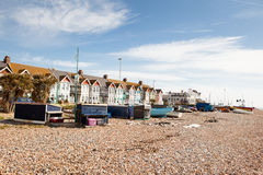 Worthing beach, West Sussex, United Kingdom. WORTHING, ENGLAND - APRIL 23. Fishing boats and huts on the beach, in Worthing, West Sussex, South England on April royalty free stock image