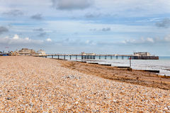 Worthing Pier. Worthing's shingle beach and Victorian Pier Royalty Free Stock Photography