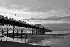 Worthing pier at dawn. Early morning photo of Worthing pier at dawn at low tide Stock Photo