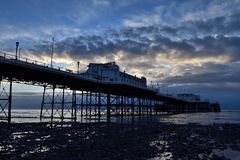 Worthing pier at dawn. Early morning photo of Worthing pier at dawn at low tide Royalty Free Stock Photo