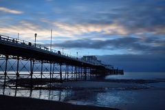 Worthing pier at dawn. Early morning photo of Worthing pier at dawn at low tide Stock Image