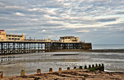 Worthing pier and groynes on the beach Stock Image