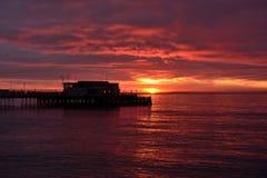 Worthing pier at sunrise. Worthing pier and seaside at sunrise Royalty Free Stock Photo