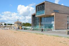 Worthing seafront and swimming pool. England. New Swimming pool building on seafront at Worthing, West Sussex, England. With people on promenade Stock Photo