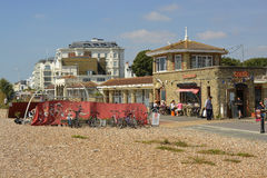 Worthing seafront, West Sussex, England. Cafe on Seafront and beach at Worthing, West Sussex, England. With people walking the promenade Stock Photos