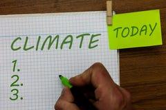 Wortschreibens-Text Klima Geschäftskonzept für Wetterbedingungen im Bereich über lange Zeitspannen des Zeit Temperatur-Mannes stockfotos