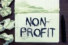 Wortschreibens-Text nicht Gewinn Geschäftskonzept für das Erbringen von Produkten oder von Dienstleistung, ohne offene Notizbuchs stockfotos