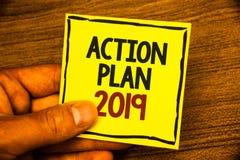 Wortschreibenstext Aktionsplan 2019 Geschäftskonzept für Herausforderungs-Ideen-Ziele, damit neues Jahr-Motivation Mann beginnt,  Lizenzfreie Stockbilder