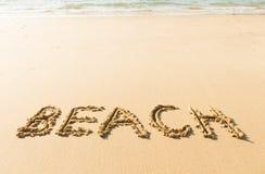 Wortstrand geschrieben auf Strand Lizenzfreie Stockfotografie