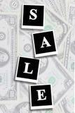 Wortverkauf auf dem Dollarhintergrund Lizenzfreies Stockfoto