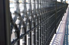Wought iron fence with repeating pattern.  Royalty Free Stock Image
