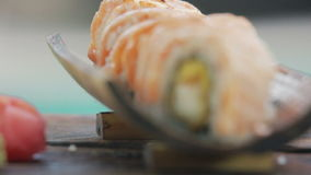 That would be tasty rolls. Selective focus on ready tasty sushi rolls stock video