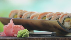 That would be tasty rolls. Selective focus on ready tasty sushi rolls stock video footage