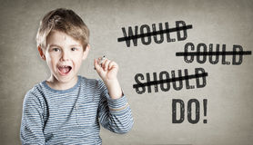 Would, could, should, do, Boy on grunge background writing Royalty Free Stock Photography