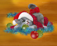 Would you like to play with me?. A kitten plays with Christmas decorations Royalty Free Stock Photography