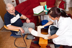 Wound care by nurses Stock Photos