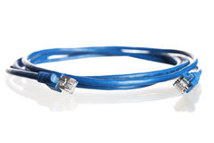 Wound-up blue network cable. Royalty Free Stock Image