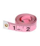 Wound up Pink Measuring Tape Roll royalty free stock image