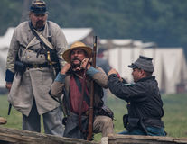 Wounded in Action. Civil War era soldiers in battle at the Dog Island reenactment in Red Bluff, California stock photos