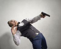 Wounded agent with a gun Stock Photos