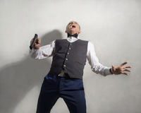 Wounded agent with a gun Royalty Free Stock Image