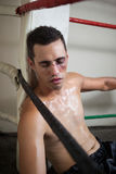 Wounded boxer relaxing in the boxing ring Stock Image