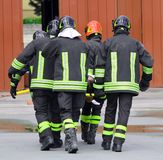 WOUNDED carried by firemen on a stretcher Stock Photo