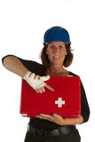 Wounded female shows firstaid kit. Wounded female with first aid kit points toward the red cross with her wounded hand Royalty Free Stock Image
