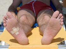 Wounded foot. And cross plaster royalty free stock photos