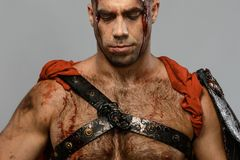 Wounded gladiator close-up Stock Image