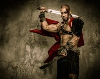 Wounded gladiator  holding sword Royalty Free Stock Photo