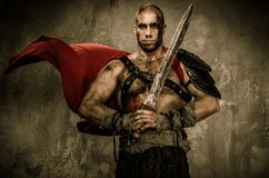 Wounded gladiator  holding sword Stock Images