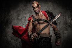 Wounded gladiator with sword Royalty Free Stock Photography